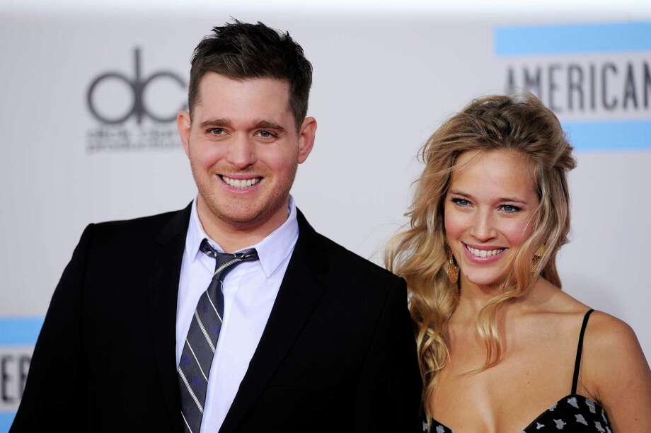 FILE - This Nov. 21, 2010 file photo shows Michael Buble, left, and Luisana Lopilato at the 38th Annual American Music Awards in Los Angeles.  The 37-year-old Canadian singer and his 25-year-old Argentine actress-wife are expecting a baby. They were married in 2011. The couple met in 2009 during a South American concert tour (AP Photo/Chris Pizzello, file) Photo: Chris Pizzello