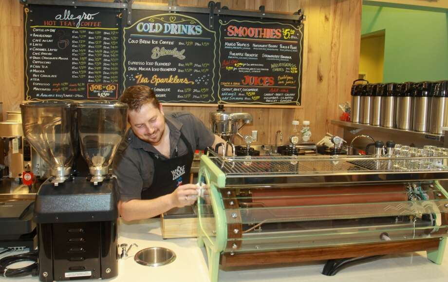 Matt McCarty setting up a La Marzocco Strada MP espresso machine in the Allegro Coffee Bar in the new Whole Foods Market in Katy, Jan. 24, 2013.