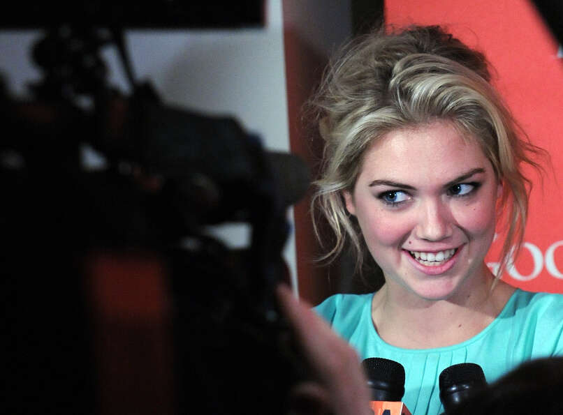 Model and actress Kate Upton talks to reporters during a red carpet event in 2012. (Photo credit sho