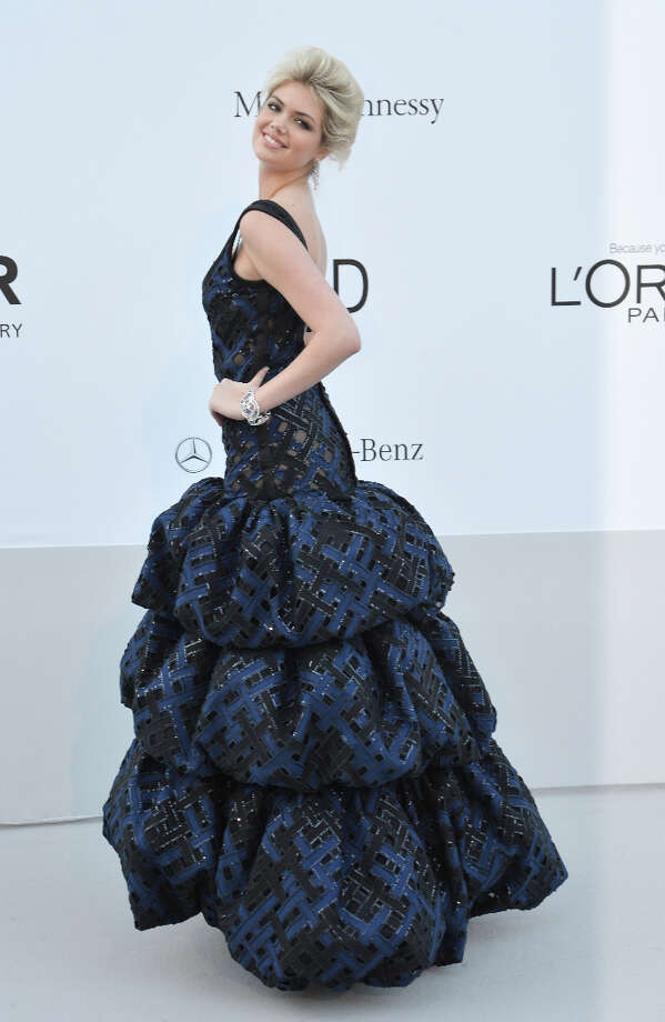... poses as she arrives to attend the 2012 amfAR's Cinema Against Aids event. (ALBERTO PIZZOLI/AFP/GettyImages) Photo: AFP, AFP/Getty Images / 2012 AFP