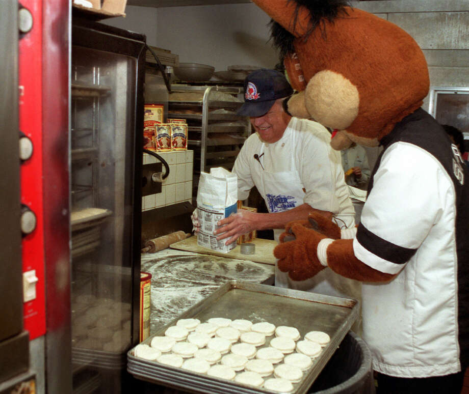 Richard Ramos and the Coyote bake biscuits for the 22nd Annual Cowboy Breakfast in 2000. Photo: CHARLES BARKSDALE, EXPRESS-NEWS FILE PHOTO / SAN ANTONIO EXPRESS-NEWS