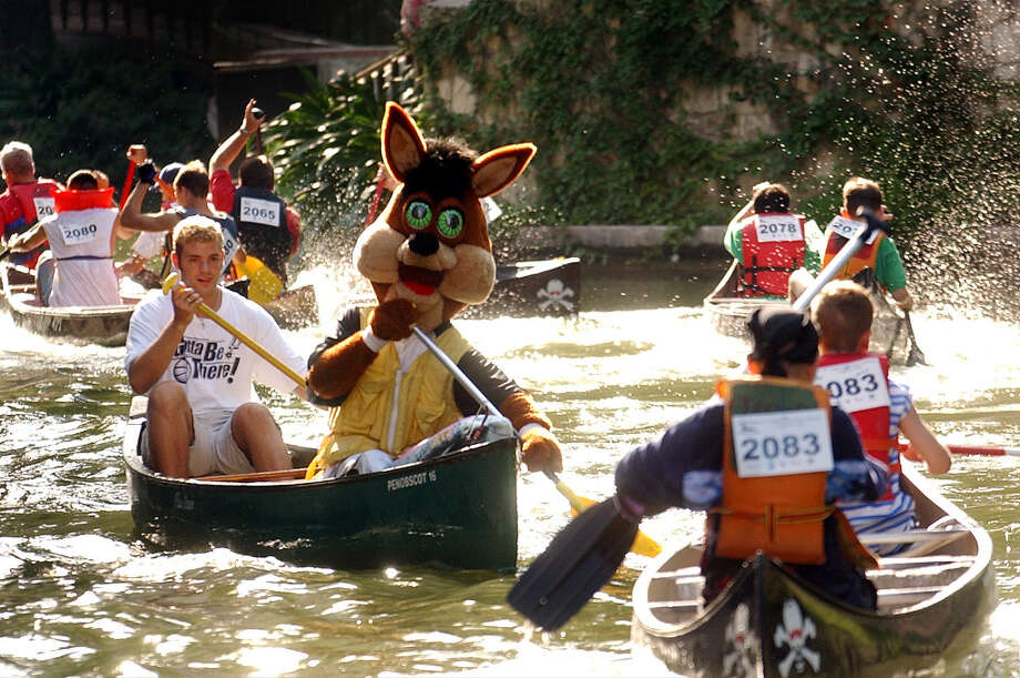 The Coyote took part in the Paseo Del Rio Association Canoe Challenge on the Riverwalk, Aug. 24, 2002. Photo: BILLY CALZADA, SAN ANTONIO EXPRESS-NEWS