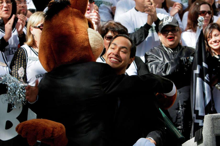 Newly elected Mayor Julian Castro gets a hug from the Coyote in 2009. Photo: JERRY LARA, San Antonio Express-News / glara@express-news.net