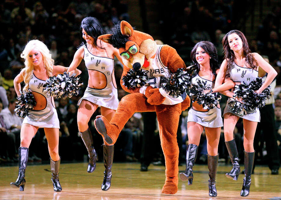 The Coyote proves he can keep up with the Silver Dancers. Photo: EDWARD A. ORNELAS, SAN ANTONIO EXPRESS-NEWS / eaornelas@express-news.net