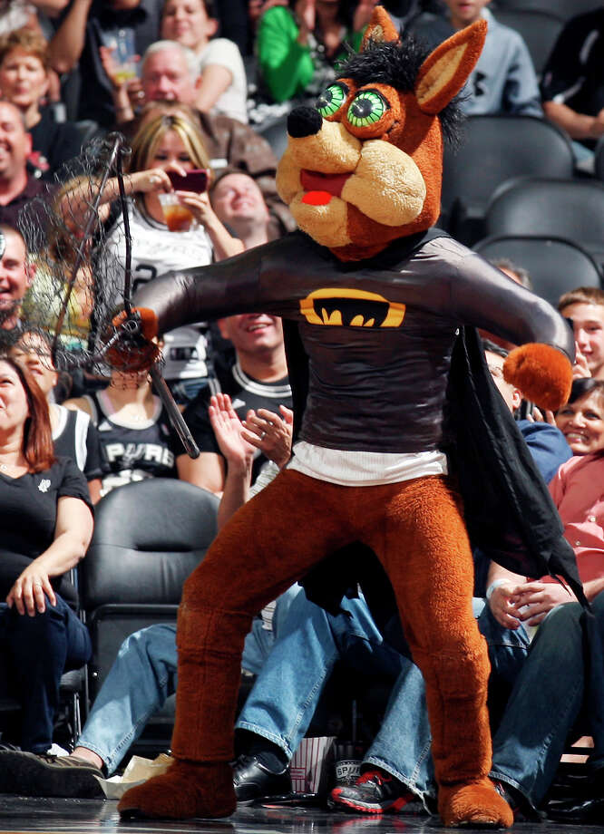 The Spurs' Coyote wears a batman costume after a bat was taken off the court during first half action of the game with the Kings, March 11, 2011, at the AT&T Center. Photo: EDWARD A. ORNELAS, SAN ANTONIO EXPRESS-NEWS / SAN ANTONIO EXPRESS-NEWS NFS