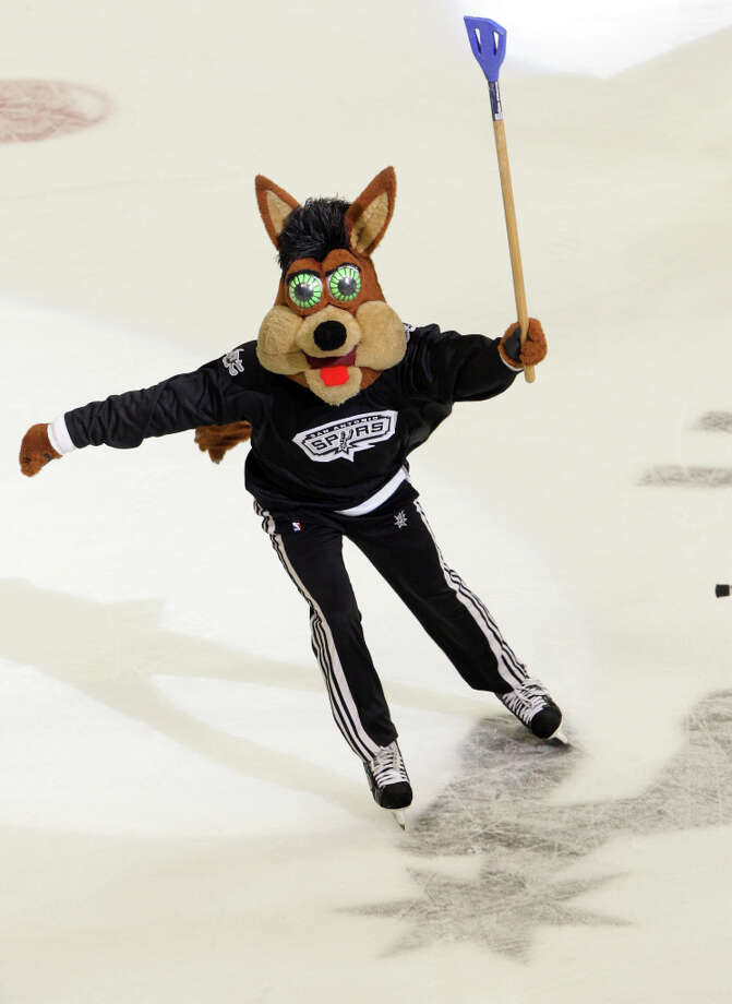 The Coyote celebrates after scoring a goal during a halftime entertainment hockey game involving other mascots in 2011. Photo: BOB OWEN, SAN ANTONIO EXPRESS-NEWS / rowen@express-news.net