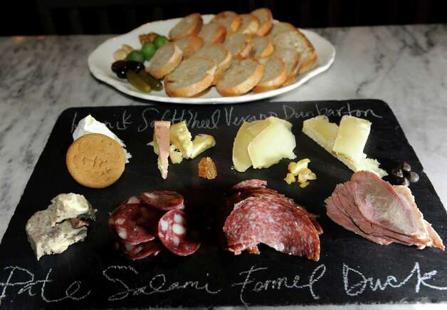 The Monger's Choice includes a selection of meats and cheese and is served with sliced bread on Friday, Jan. 18, 2013, at The Charles F. Lucas Confectionery and Wine Bar in Troy, N.Y. (Cindy Schultz / Times Union) Photo: Cindy Schultz / 00020821A