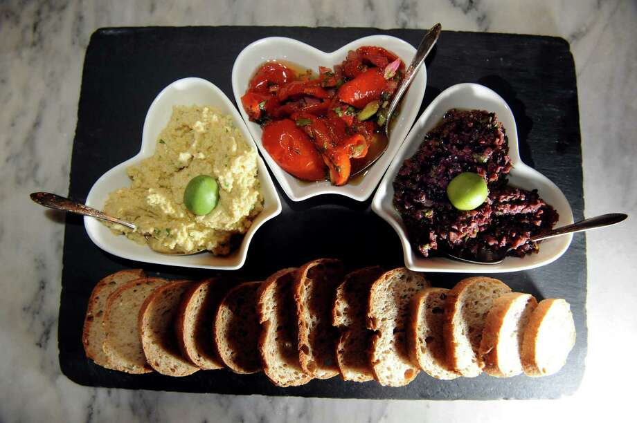 House hummus, fire-roasted tomato salad and kalamata olive tapenade served with sliced bread on Friday, Jan. 18, 2013, at Lucas Confectioneryin Troy, N.Y. (Cindy Schultz / Times Union) Photo: Cindy Schultz / 00020821A