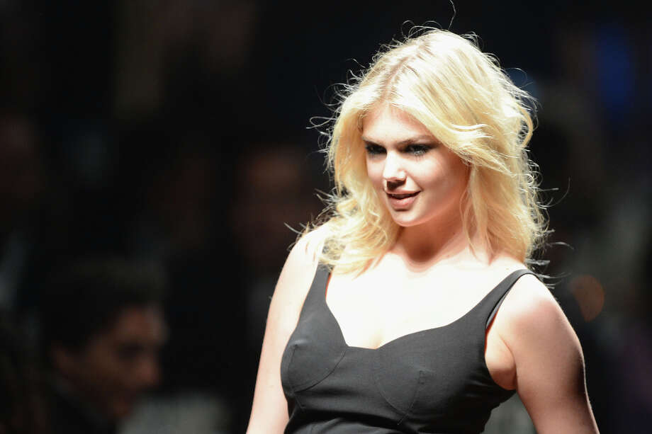 Upton walks the runway during the 2012 amfAR's Cinema Against AIDS event. Photo: Dave J Hogan, Getty Images / 2012 Dave J Hogan