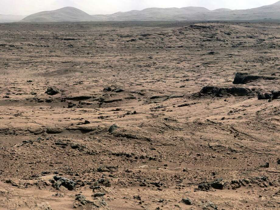 "''Panoramic View From 'Rocknest' Position of Curiosity Mars Rover''This panorama is a mosaic of images taken by the Mast Camera on the NASA Mars rover Curiosity while the rover was working at a site called ""Rocknest"" in October and November 2012. Photo: Caltech/MSSS / NASA/JPL"