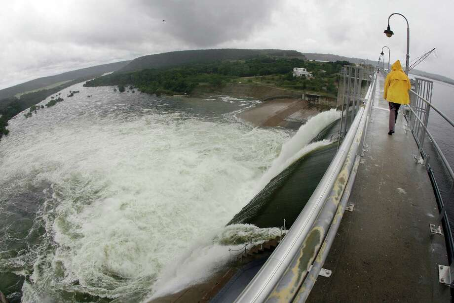In the wake of recent heavy rains, The Brazos River Authority has opened three of the nine floodgates on the Morris Sheppard Dam on Possum Kingdom Lake in Texas, Thursday, June 28, 2007. (Tom Pennington/Fort Worth Star-Telegram/MCT) Photo: Tom Pennington, MBR / Fort Worth Star-Telegram