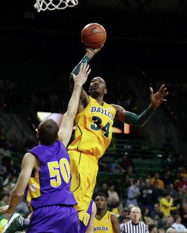 Baylor's Cory Jefferson (34), right, shoots over Hardin-Simmons' Jeff Holland (50), left, in the second half of an NCAA college basketball game, Saturday, Jan. 19, 2013, in Waco, Texas. (AP Photo/Waco Tribune Herald, Rod Aydelotte) Photo: Rod Aydelotte, Associated Press / Waco Tribune Herald