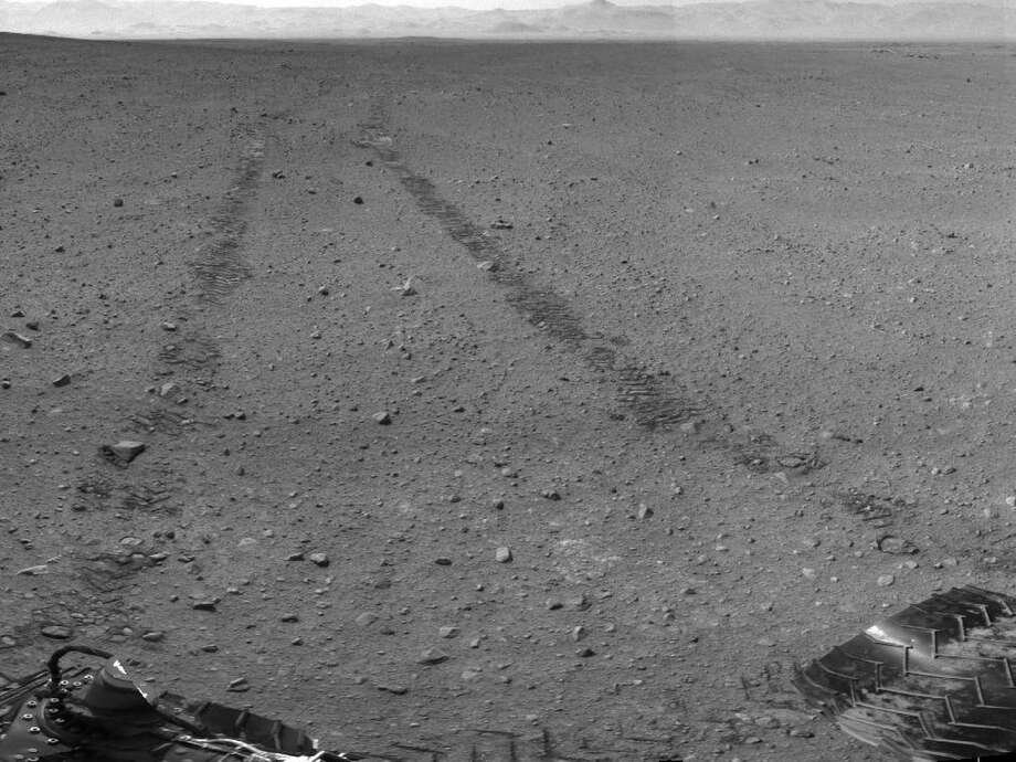 ''Curiosity's Location During Arm Checkouts''This scene shows the surroundings of the location where NASA Mars rover Curiosity arrived on the 29th Martian day of the rover's mission on Mars, September 4, 2012. It is a mosaic of images taken by Curiosity's Navigation Camera. Photo: Caltech/MSSS / NASA/JPL