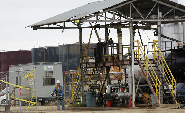 Work continues at the Blue Dolphin Energy Nixon refinery, near Nixon, Texas, Thursday, Jan. 24, 2013. The plant was built around 1980 but was mothballed for years. Blue Dolphin, out of Houston, bought the plant in 2006 and is now processing Eagle Ford Shale crude. Photo: Jerry Lara, San Antonio Express-News / © 2013 San Antonio Express-News