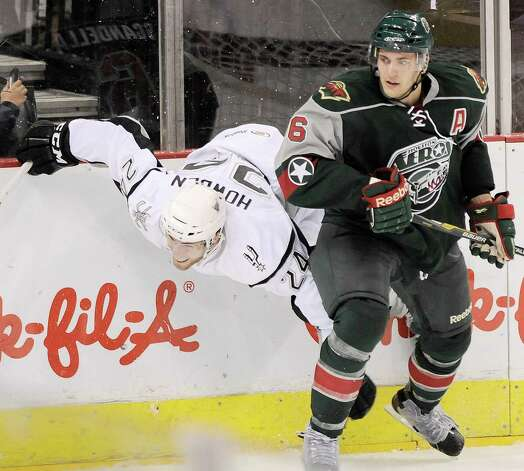 Houston Aeros' Marco Scandella (6) upends San Antonio Rampage's Quinton Howden during the third period of an AHL hockey game, Sunday, Oct. 14, 2012, in San Antonio. San Antonio won 3-2. Photo: Darren Abate, EN / Darren Abate/pressphotointl.com