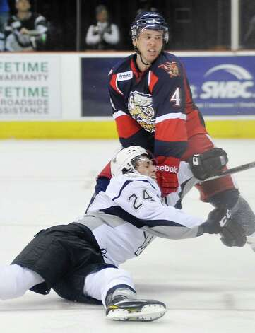 San Antonio Rampage's Quinton Howden (24) is taken down by Grand Rapids Griffins' Nathan Paetsch during the second period of an AHL hockey game, Friday, Nov. 2, 2012, in San Antonio. Photo: Darren Abate, EN / Darren Abate/pressphotointl.com