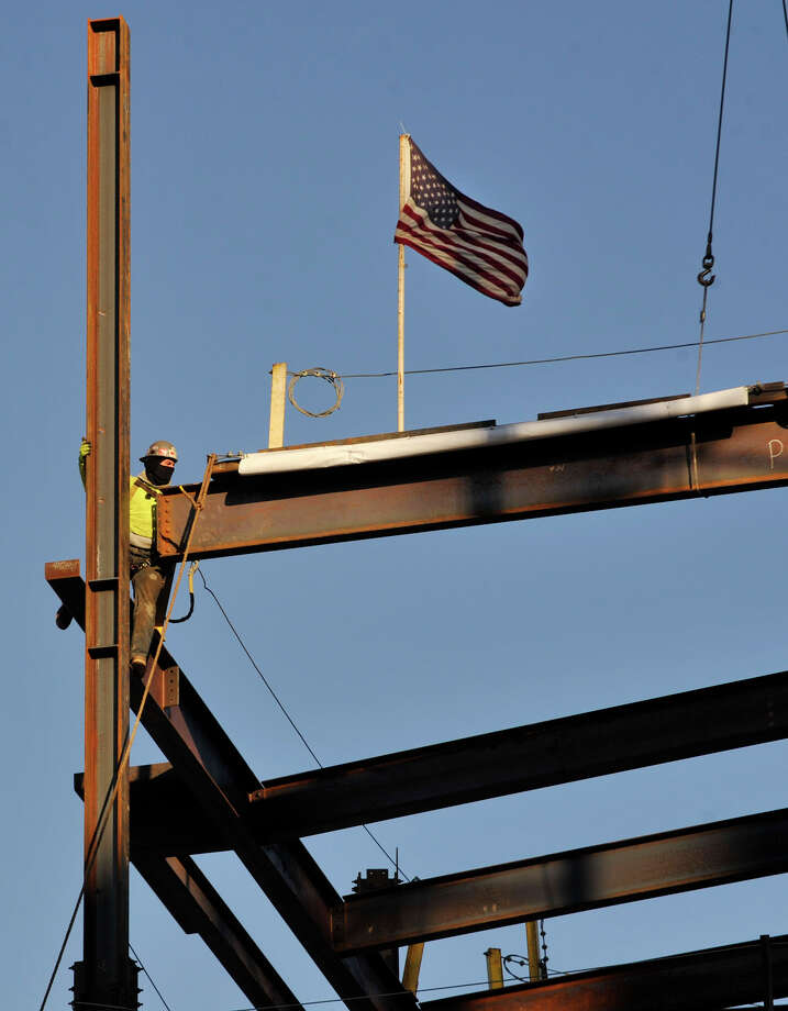 A ceremonial steel girder is put into place on the new addition to Danbury Hospital on Thurday, Jan. 24, 2013. Photo: Jason Rearick / The News-Times