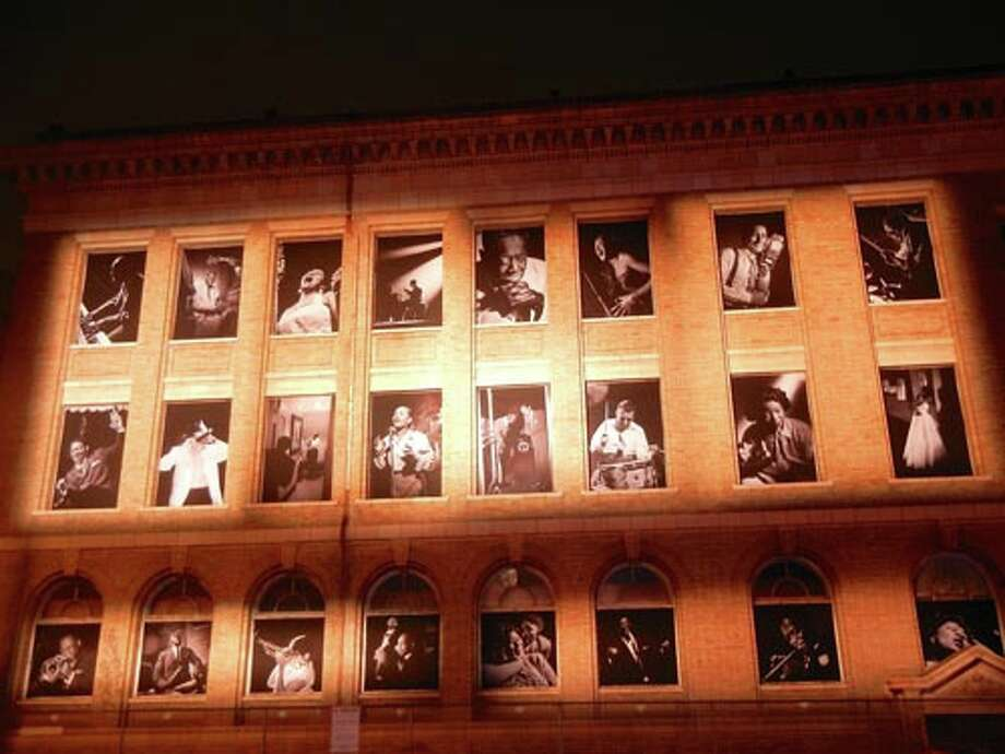 Herman Leonard's photographs of jazz greats adorn a building across Franklin Street
