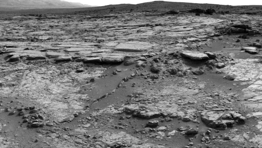 "'''Snake River' Rock Feature Viewed by Curiosity Mars Rover''The sinuous rock feature in the lower center of this mosaic of images recorded by the NASA Mars rover Curiosity is called ""Snake River."" The images in the mosaic were taken by Curiosity's Navigation Camera during the 133rd Martian day of the rover's mission on Mars, December 20, 2012. Photo: Caltech/MSSS / NASA/JPL"