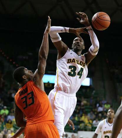 Baylor's Cory Jefferson, right, loses the ball while driving on Oklahoma State's Marcus Smart during the second half of an NCAA college basketball game, Monday, Jan. 21, 2013, in Waco, Texas. Baylor won 64-54. (AP Photo/Waco Tribune Herald, Rod Aydelotte) Photo: Rod Aydelotte, Associated Press / Waco Tribune Herald