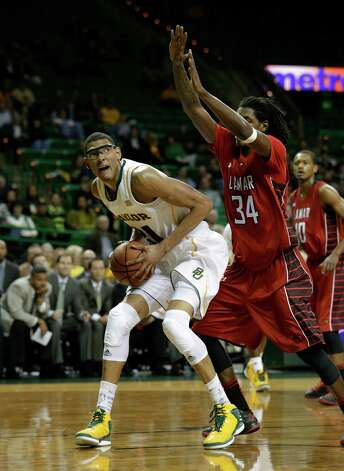 Baylor center Isaiah Austin (21) positions for a shot against Lamar forward Amos Wilson (34) during an NCAA college basketball game Wednesday, Dec. 12, 2012, in Waco, Texas. (AP Photo/Tony Gutierrez) Photo: Tony Gutierrez, Associated Press / AP