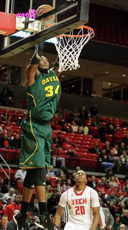 Baylor's Cory Jefferson, left, dunks ahead of Texas Tech's Toddrick Gotcher during their NCAA college basketball game in Lubbock, Texas, Tuesday, Jan. 8, 2013. (AP Photo/The Avalanche-Journal, Zach Long) ALL LOCAL TV OUT Photo: Zach Long, Associated Press / The Avalanche-Journal