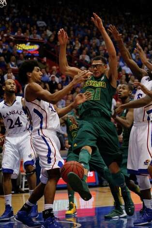 Kansas forward Kevin Young (40) and Baylor center Isaiah Austin (21) during the second half of an NCAA college basketball game in Lawrence, Kan., Monday, Jan. 14, 2013. Kansas defeated Baylor 61-44. (AP Photo/Orlin Wagner) Photo: Orlin Wagner, Associated Press / AP