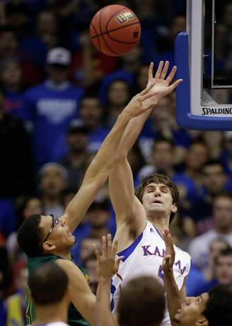 Kansas center Jeff Withey, right, blocks a shot by Baylor center Isaiah Austin, left, during the first half of an NCAA college basketball game in Lawrence, Kan., Monday, Jan. 14, 2013. (AP Photo/Orlin Wagner) Photo: Orlin Wagner, Associated Press / AP