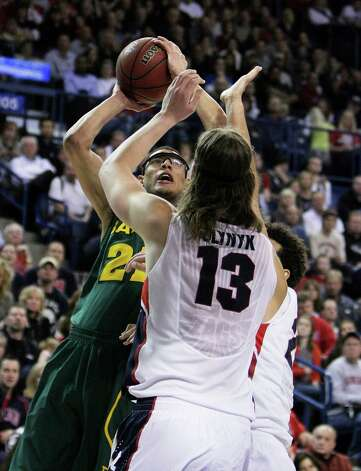 Baylor's Isaiah Austin (21) is attempts a layup against Gonzaga's Kelly Olynyk (13) and Elias Harris during the second half of an NCAA college basketball game in Spokane, Wash. on Friday, Dec. 28, 2012. Gonzaga won 94-87. (AP Photo/Young Kwak) Photo: YOUNG KWAK, Associated Press / FR159675 AP