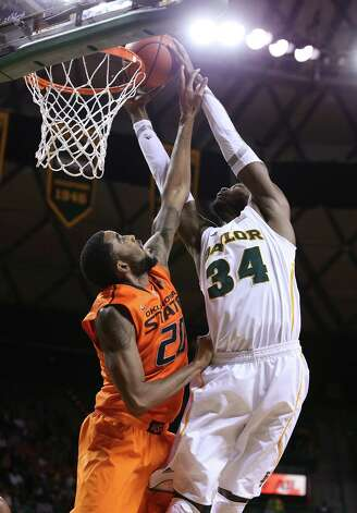 Baylor's Cory Jefferson scores over Oklahoma State Michael Cobbins, left, during the second half of an NCAA college basketball game, Monday, Jan. 21, 2013, in Waco, Texas. Baylor won 64-54. (AP Photo/Waco Tribune Herald, Rod Aydelotte) Photo: Rod Aydelotte, Associated Press / Waco Tribune Herald