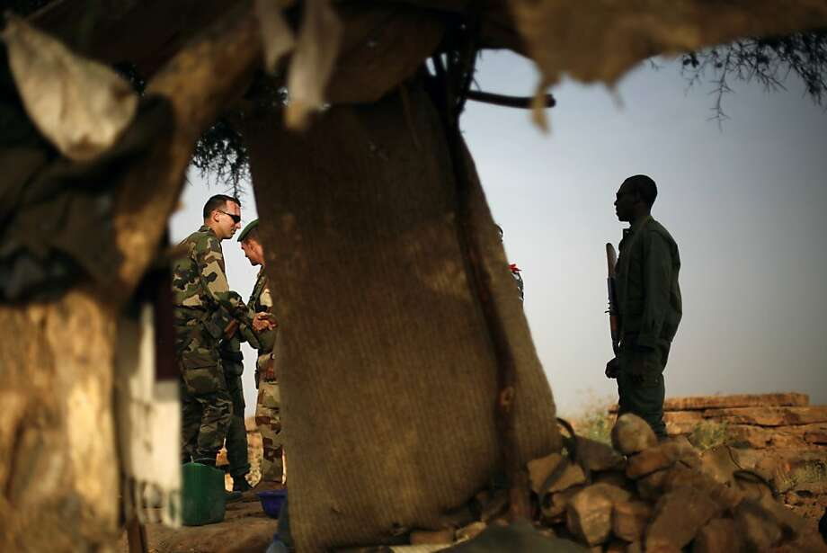 French soldiers meet with their Malian counterparts at an observation post outside Sevare, about 400 miles north of Mali's capital, Bamako. Photo: Jerome Delay, Associated Press