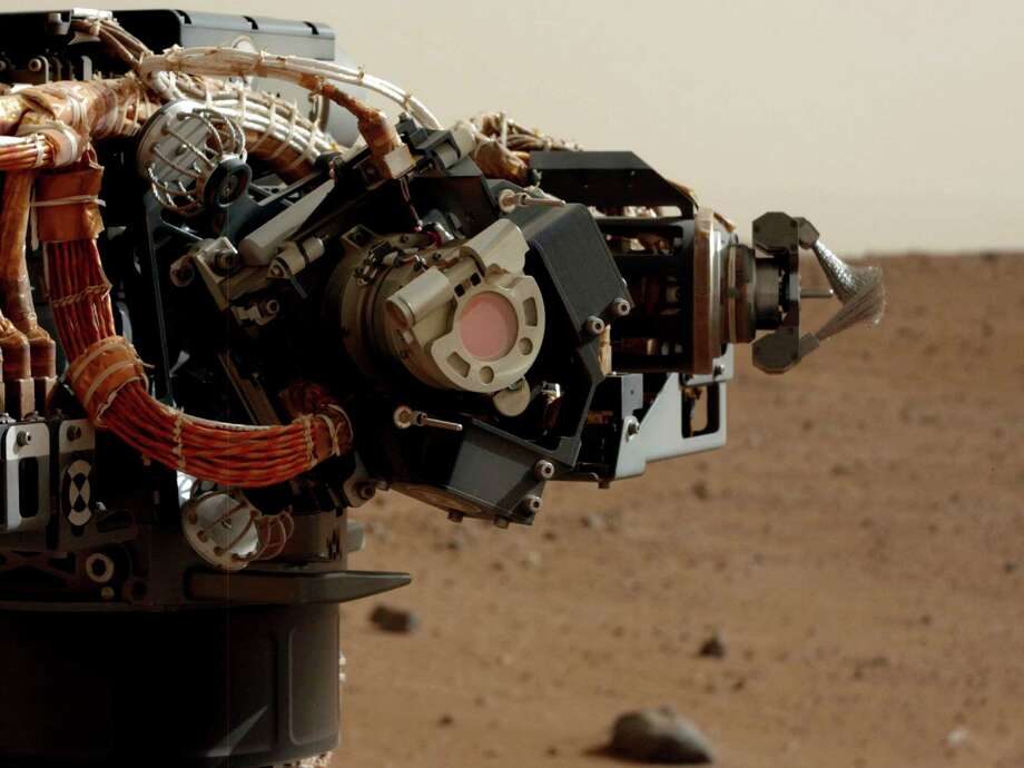''Camera on Curiosity's Arm as Seen by Camera on Mast''The left eye of the Mast Camera took this image of the camera on the rover's arm, the Mars Hand Lens Imager (MAHLI), during the 30th Martian day, or sol, of the rover's mission, September 5, 2012. Photo: Caltech/MSSS / NASA/JPL