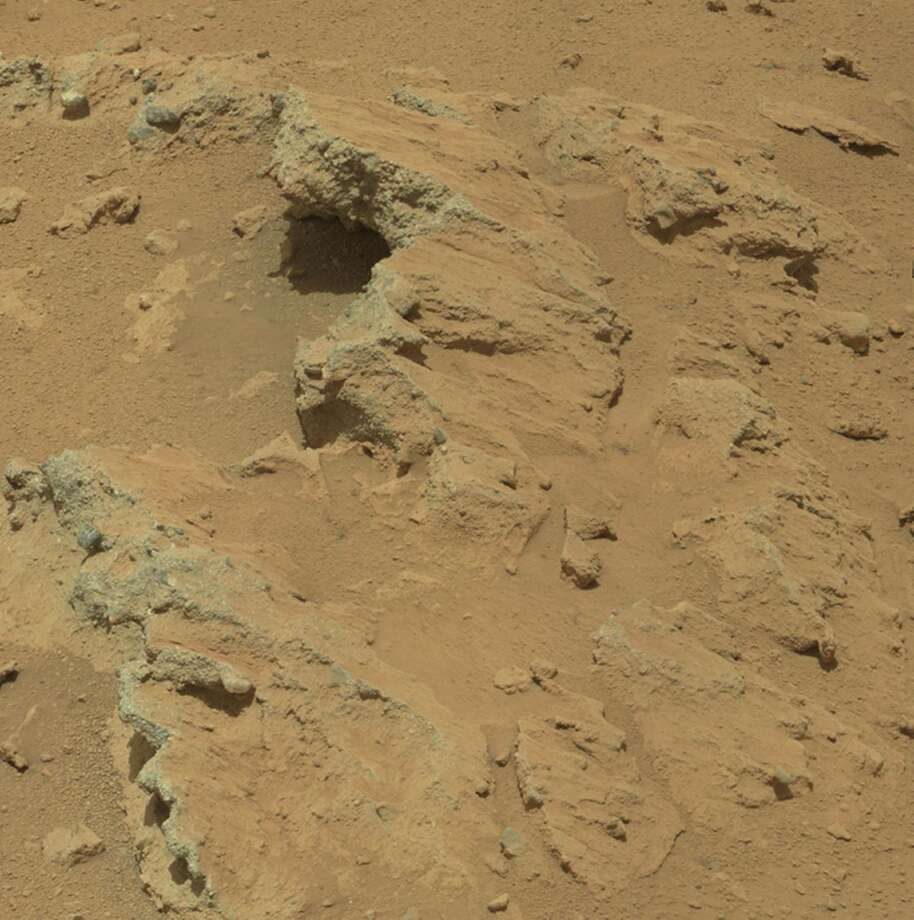 "''Remnants of Ancient Streambed on Mars''NASA's Curiosity rover found evidence for an ancient, flowing stream on Mars at a few sites, including the rock outcrop pictured here, which the science team has named ""Hottah"" after Hottah Lake in Canada's Northwest Territories. It may look like a broken sidewalk, but this geological feature on Mars is actually exposed bedrock made up of smaller fragments cemented together, or what geologists call a sedimentary conglomerate. Scientists theorize that the bedrock was disrupted in the past, giving it the titled angle, most likely via impacts from meteorites. Photo: Caltech/MSSS / NASA/JPL"