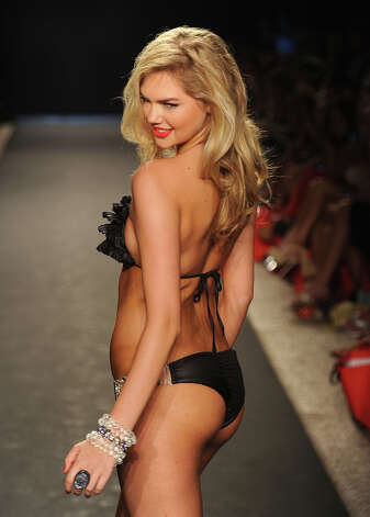 Upton walks the runway at the Beach Bunny Swimwear show during Merecdes-Benz Fashion Week Swim 2012 in 2011 in Miami Beach, Florida. Photo: Frazer Harrison / 2011 Getty Images