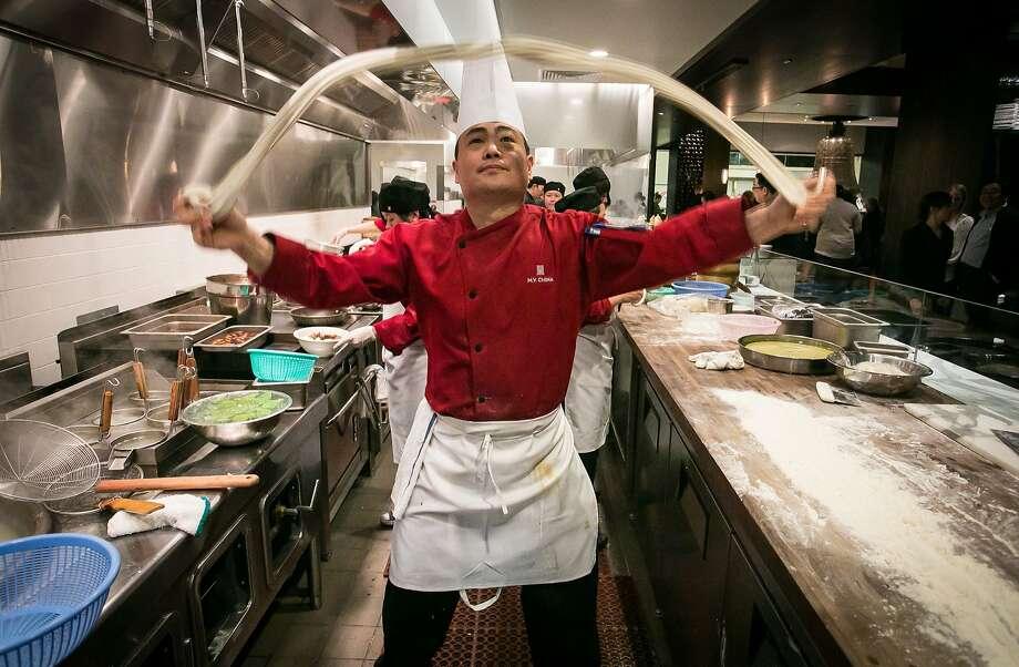 Executive Chef Tony Wu tosses noodles at My China restaurant in San Francisco, Calif. on Saturday, January 19th, 2013. Photo: John Storey