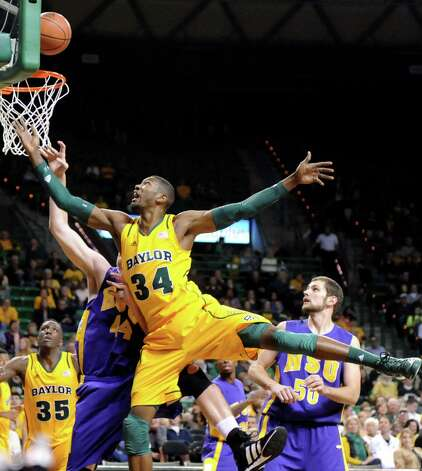 Baylor's Cory Jefferson (34) drives against Hardin-Simmons' Andy Spears (44), left, and Jeff Holland (50), right, in the first half of an NCAA college basketball game, Saturday, Jan. 19, 2013, in Waco, Texas. (AP Photo/Waco Tribune Herald, Rod Aydelotte) Photo: Rod Aydelotte, Associated Press / Waco Tribune Herald
