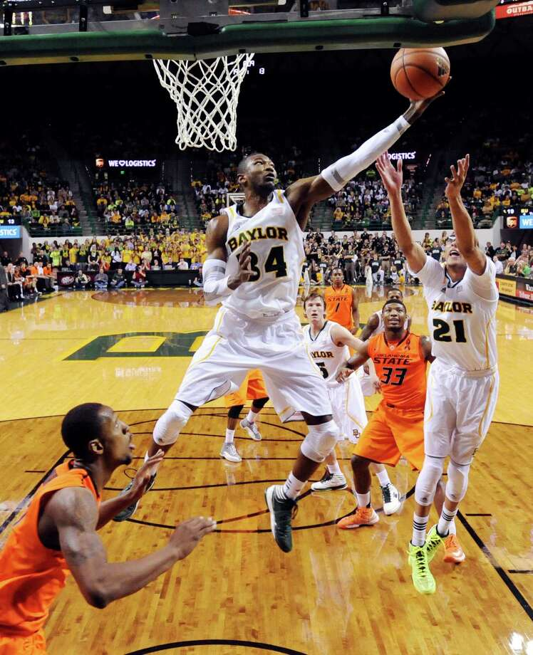 Baylor's Cory Jefferson (34) reaches fore a loose rebound over Isaiah Austin (21) and Oklahoma State's Kamari Murphy, left, during the first half of an NCAA college basketball game, Monday, Jan. 21, 2013, in Waco, Texas. (AP Photo/The Waco Tribune-Herald, Rod Aydelotte) Photo: Rod Aydelotte, Associated Press / The Waco Tribune-Herald