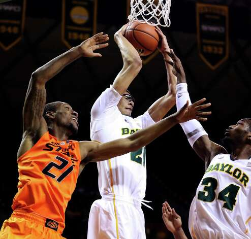 Baylor's Isaiah Austin (21) pulls down a rebound over Cory Jefferson (34) and Oklahoma State's Kamari Murphy (21) during the first half of an NCAA college basketball game, Monday, Jan. 21, 2013, in Waco, Texas. (AP Photo/The Waco Tribune-Herald, Rod Aydelotte) Photo: Rod Aydelotte, Associated Press / The Waco Tribune-Herald