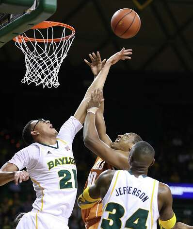 Baylor Isaiah Austin (21) blocks the shot of Texas' Jonathan Holmes, center, as Baylor's Cory Jefferson (34) look on during the first half of an NCAA college basketball game, Saturday, Jan. 5, 2013, in Waco, Texas. (AP Photo/Waco Tribune Herald, Rod Aydelotte) Photo: Rod Aydelotte, Associated Press / Waco Tribune Herald
