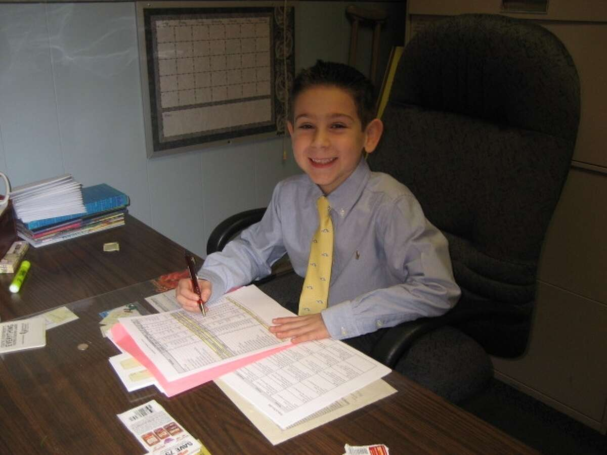 One of the most actively bid upon items at our Annual Auction is ?The Principal for a Day? certificate. Last year, the family of our second grader, Christian Teitsch, was the highest bidders and Christian assumed his role just before our Christmas vacation. Christian began the day with morning assembly, visited the classrooms to check on everyone, performed morning and afternoon outside duty and found time to complete the necessary paperwork for the day. This year?s auction is themed ?Mardi Gras? and will be held at the Franklin Terrace on Saturday, February 9th. We wonder who our next principal will be!