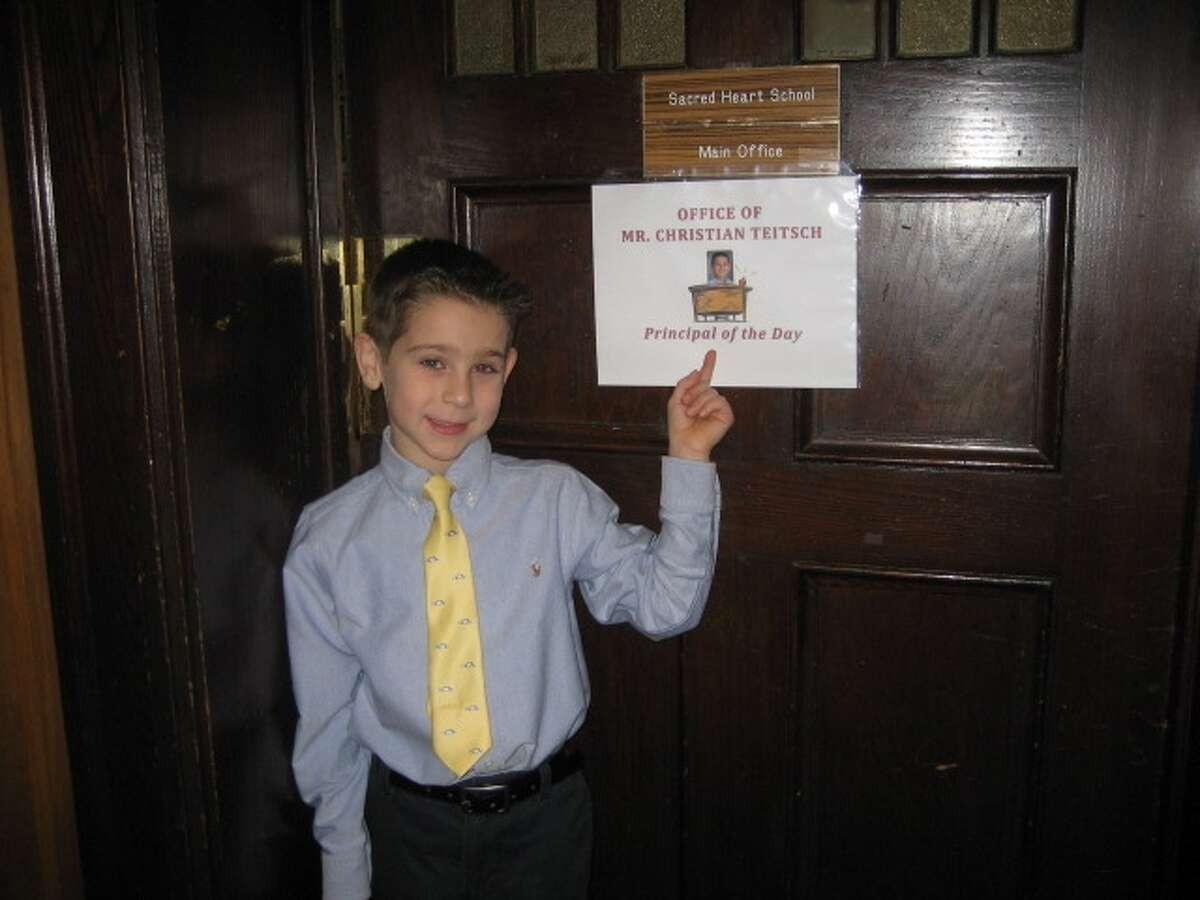 Sacred Heart School of Troy second-grader Christian Teitsch is ?Principal for a Day? after his family was the high bidder during the school?s annual auction. Christian began the day with a morning assembly, visited classrooms, performed morning and afternoon outside duty and found time to complete the necessary paperwork for the day. (Karen Snyder)