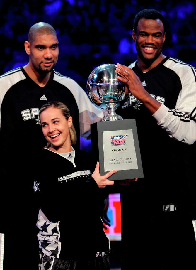 The Silver Stars' Becky Hammon holds the trophy with the Spurs' Tim Duncan, left, and former Spurs player David Robinson after they won the shooting stars competition, Feb. 16, 2008, at the NBA All Star Weekend in New Orleans. Photo: Eric Gay, AP / AP