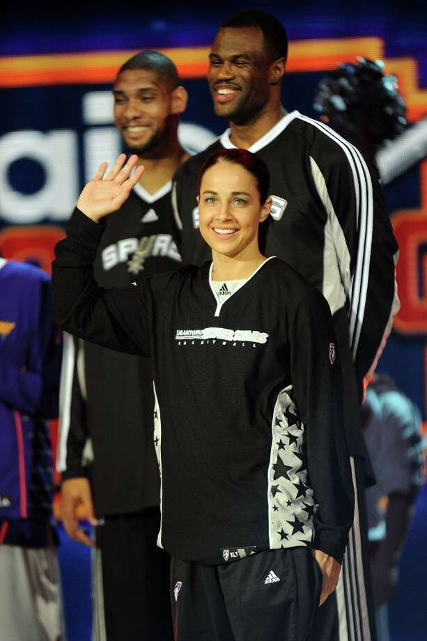 Becky Hammon of the Silver Stars is introduced as she participates with Tim Duncan of the Spurs and former Spur David Robinson in the Haier Shooting Stars on All-Star Saturday Night, part of 2009 NBA All-Star Weekend at US Airways Center on Feb. 14, 2009 in Phoenix. Photo: Noah Graham, NBAE/Getty Images / 2009 NBAE
