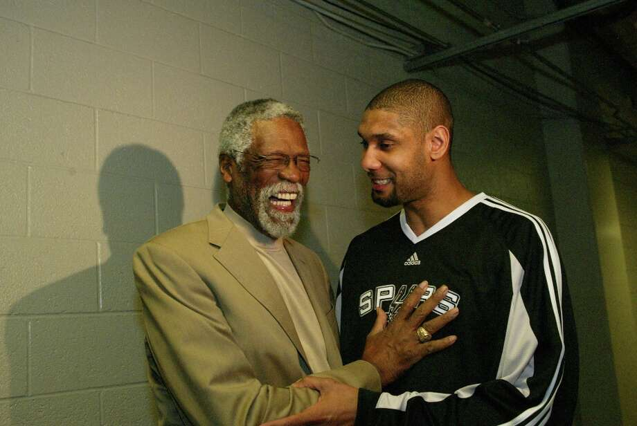 NBA Legend Bill Russell and Tim Duncan of the Spurs share a laugh prior to the Haier Shooting Stars competition as part of 2009 NBA All-Star Weekend at US Airways Center on Feb. 14, 2009 in Phoenix. Photo: Ray Amati, NBAE/Getty Images / 2009 NBAE