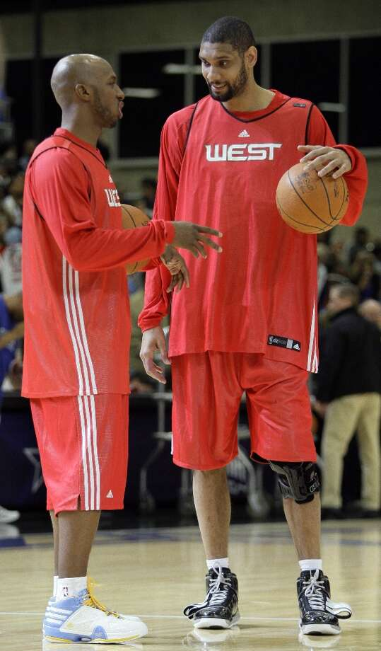 West All-Stars Chauncey Billups (left) of the Nuggets and Tim Duncan of the Spurs talk during the West All-Star team practice on NBA basketball All-Star Weekend Saturday, Feb. 13, 2010, in Dallas. Photo: Tony Gutierrez, AP / AP