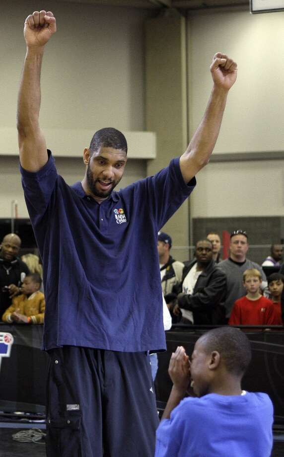West All-Star Tim Duncan (left) of the Spurs cheers for a Special Olympics athlete during the NBA All-Star Special Olympics clinic on the NBA basketball All-Star Weekend Saturday, Feb. 13, 2010, in Dallas. Photo: Tony Gutierrez, AP / AP