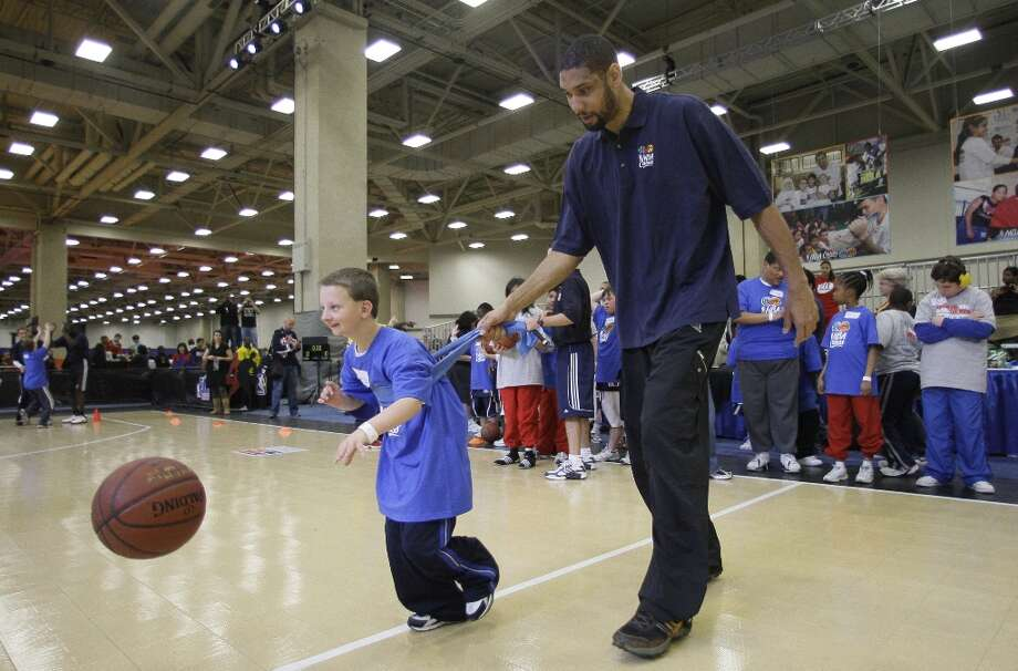 West All-Star Tim Duncan (right) of the Spurs helps Special Olympics athlete Bailey Kwasnia of Mesquite, Texas during the NBA All-Star Special Olympics clinic on the NBA basketball All-Star Weekend Saturday, Feb. 13, 2010, in Dallas. Photo: Tony Gutierrez, AP / AP