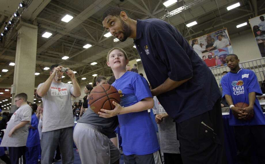 West All-Star Tim Duncan (right) of the Spurs helps Special Olympics athlete Chase Wood of Rockwall, Texas, during the NBA All-Star Special Olympics clinic on the NBA basketball All-Star Weekend Saturday, Feb. 13, 2010, in Dallas. Photo: Tony Gutierrez, AP / AP