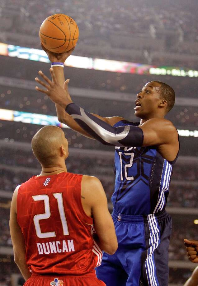 East All-Star Dwight Howard of the Magic (12) shoots over West All-Star Tim Duncan of the Spurs (21) in the first quarter of the NBA All-Star Game Sunday, Feb. 14, 2010, at Cowboys Stadium in Arlington. Photo: Eric Gay, AP / AP