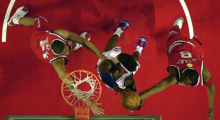 The Spurs' Tim Duncan (21), West, Detroit Pistons Ben Wallace (3), East, and Los Angeles Lakers Kobe Bryant (8), West, vie for the ball under the basket during first half play of the 2003 NBA All Star Game in Atlanta Sunday, Feb. 9, 2003. Photo: JOHN BAZEMORE, AP / AP
